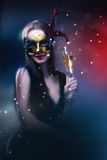Woman wearing carnival venetian mask on blur background. stock photos