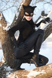 Woman wearing catsuit and mask. Beautiful young woman wearing catsuit and mask royalty free stock photography