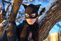 Woman wearing  catsuit and mask Stock Photography