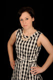 Woman wearing check dress Stock Image