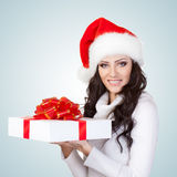 Woman wearing christmas hat Royalty Free Stock Images