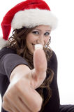 Woman wearing christmas hat. Showing you good luck sign on an isolated background Royalty Free Stock Photo