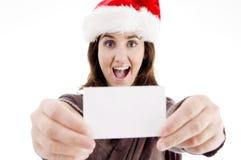 Woman wearing christmas hat displaying business Stock Photos