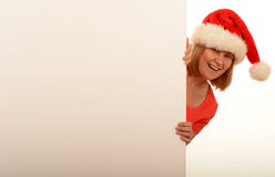 Woman wearing Christmas hat Stock Image