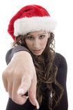Woman wearing christmas hat pointing you. With white background Stock Photo