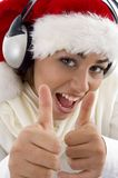 Woman wearing christmas hat and showing thumbs up Royalty Free Stock Images
