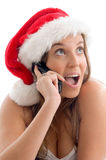 Woman wearing christmas hat and talking Stock Photo