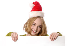 Woman wearing christmas holding blank sign Stock Photography