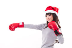 Woman wearing christmas santa hat, boxing to space Royalty Free Stock Photo