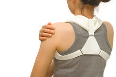 Woman wearing clavicle brace for immobilize shoulder. Clavicle support for fracture clavicle royalty free stock photo