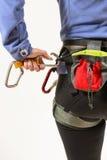 Woman wearing climbing equipment Stock Images