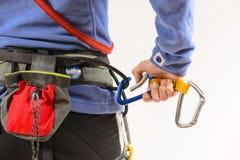 Woman wearing climbing equipment Stock Photography