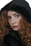 Woman wearing cloak Stock Image