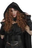 Woman wearing cloak. Beautiful woman wearing a long black cloak stock photo