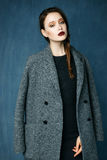 Woman wearing in coat Royalty Free Stock Photography