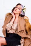 Woman wearing coat with fur Royalty Free Stock Photos