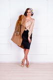 Woman wearing coat with fur Stock Photos