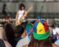 Woman Wearing Colorful Baseball Cap at Concert Stock Photography