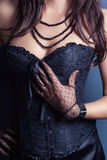 Woman wearing corset Royalty Free Stock Photos