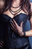 Woman wearing corset Royalty Free Stock Photos
