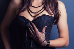 Woman wearing corset Stock Images