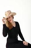 Woman wearing a cowboy hat. Young woman wearing a cowboy hat and winking royalty free stock photo