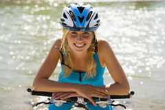 A woman wearing a cycling helmet. Royalty Free Stock Image