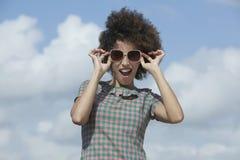 Woman wearing dark sunglasses Stock Photography