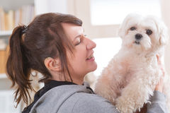 Woman wearing deaf aid with her dog Royalty Free Stock Photos