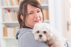 Woman wearing deaf aid with her dog Stock Image