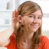Woman wearing deaf aid Royalty Free Stock Images