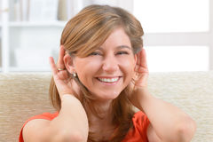 Woman wearing deaf aid Stock Images