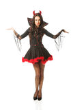 Woman wearing devil clothes Stock Image