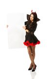 Woman wearing devil clothes holding white banner Royalty Free Stock Photo