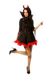 Woman wearing devil clothes pointing up Royalty Free Stock Images