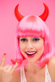 Woman wearing devil horns Royalty Free Stock Images