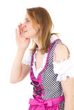 Woman wearing dirndl whispering to her friend Stock Photos
