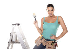 DIY woman. A woman wearing a DIY tool belt full of a variety of useful tools on a white background Stock Photography