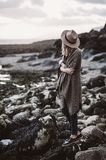 Woman Wearing Draped Coat Standing on Rock Facing Mountain Royalty Free Stock Images