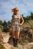 Woman wearing dress on beach Stock Photography
