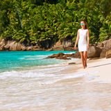 Woman wearing dress on beach at Seychelles Stock Photography