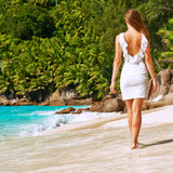 Woman wearing dress on beach at Seychelles Royalty Free Stock Images
