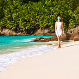 Woman wearing dress on beach at Seychelles Stock Photo