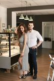 Man and woman standing at cafe. stock image