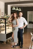 Man and pretty woman standing at cafe. royalty free stock photos