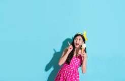 Woman wearing dress standing on blue background Royalty Free Stock Photography