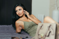 Woman wearing dress talking on cell phone Stock Images