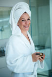 woman wearing a dressing gown holding face powder Royalty Free Stock Photography