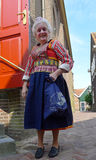 Woman wearing the Dutch traditional costume. In Edam Stock Photography
