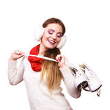 Woman wearing ear muffs holding ice skate. Winter sport activity concept. Girl wearing ear muffs, warm jumper and red scarf holding ice skate, isolated royalty free stock photos